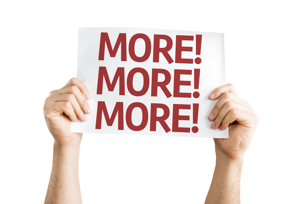 Go deeper, give them more. Dig deeper and give your customers more. hands holding up a white card  with More! More! More! written in red