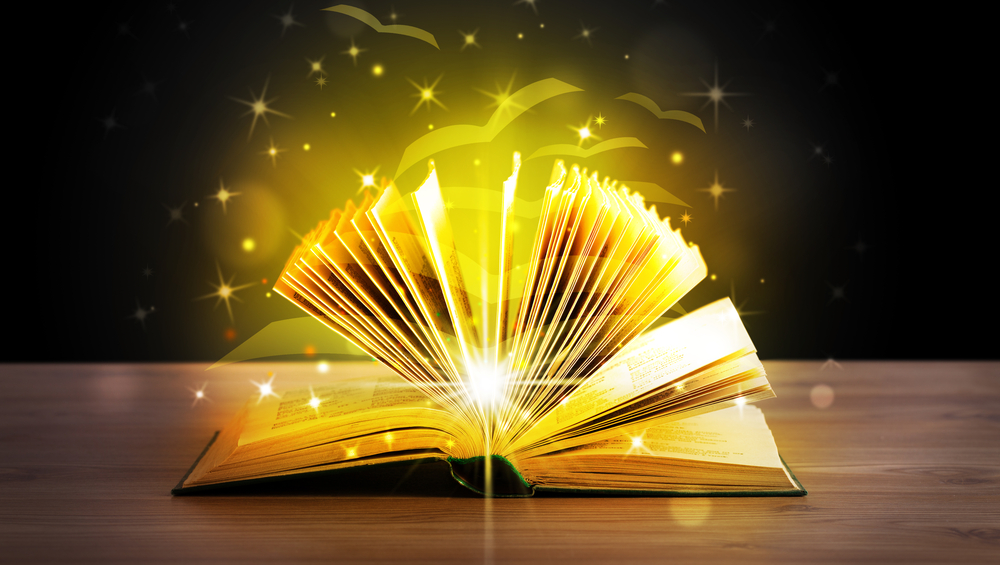 All on the same page. Open book with magical golden glowing pages of when your team are all on the same page