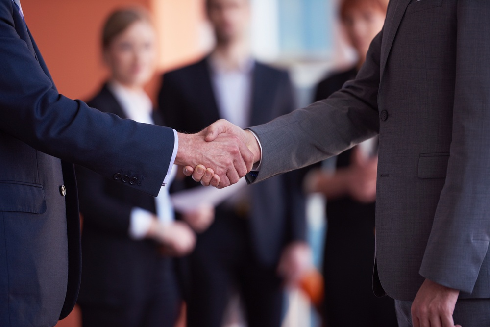 Service is the new sales. two businessman handshake, service can make or break a deal